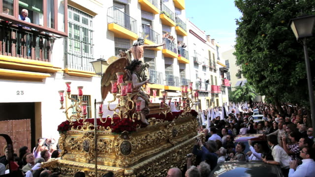people following the costaleros bearing a trono in a procession through the streets of malaga, andalucia, spain, europe - holy week stock videos & royalty-free footage