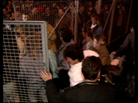 people forcing open gate at checkpoint charlie opening of berlin wall 09 nov 89 - bbc archive stock-videos und b-roll-filmmaterial