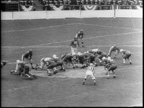 People form a giant V on the field / East Army AllStars vs the New York Football Giants / Soldiers in uniform march out on the field / Colonel Robert...