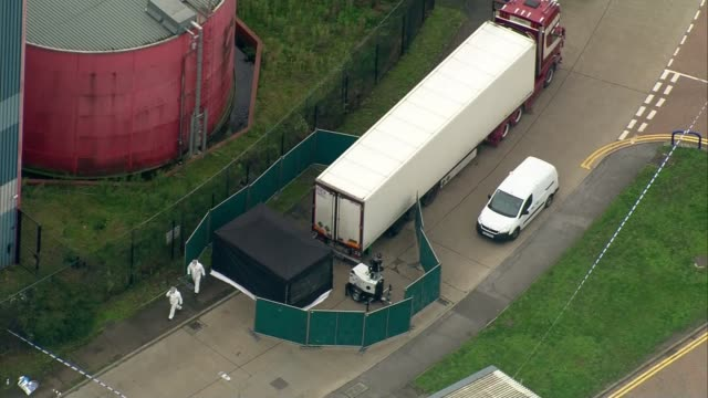 people found dead inside lorry in essex - aerials; england: essex: grays: waterglade industrial park: ext air views container lorry parked in... - articulated lorry stock videos & royalty-free footage