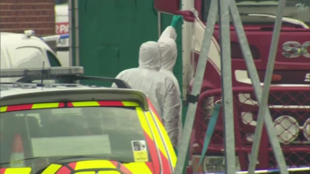 people found dead inside lorry in essex; england: essesx: grays: waterglade industrial park ext forensic officers examining lorry cab ambulance along... - エセックス州点の映像素材/bロール