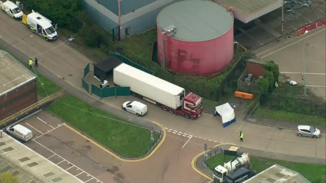people found dead inside lorry in essex; england: essex: grays: ext air views various shots crime scene with forensic tent beside lorry - エセックス州点の映像素材/bロール