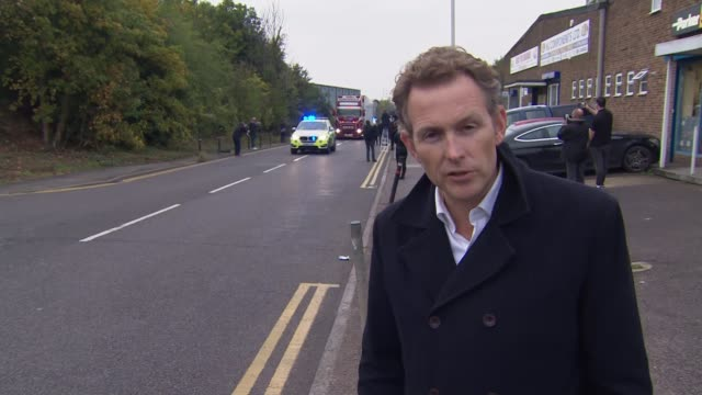people found dead inside lorry in essex; england: essex: grays: waterglade industrial park: ext reporter to camera [as lorry - in which bodies of 39... - エセックス州点の映像素材/bロール