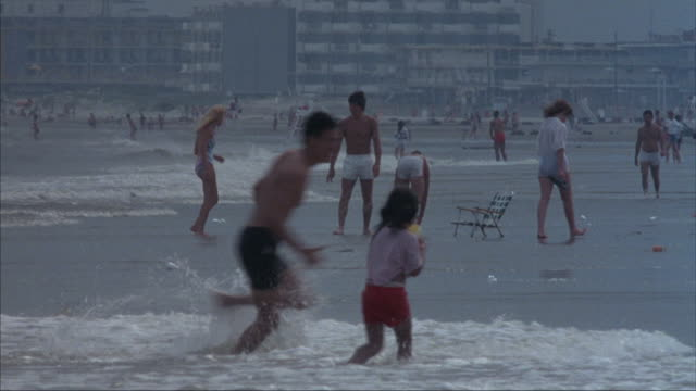 people frolic on a malibu beach. - one piece swimsuit stock videos & royalty-free footage