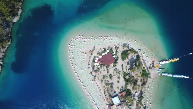 people from all over the world are returning to turkey to enjoy some of the world's best beaches the country's southwestern resort town of fethiye in... - mugla province stock videos & royalty-free footage
