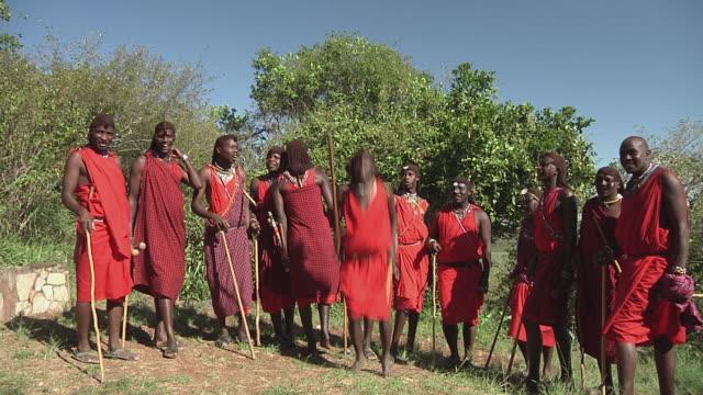 MS People from Masai tribe performing traditional dance / Nairobi,  Masai Mara National Reserve, Kenya