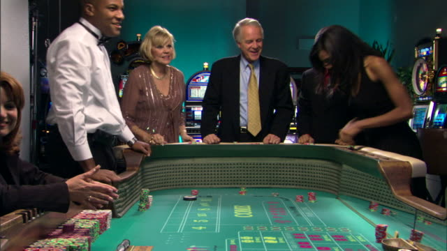people gambling in casino - craps stock videos & royalty-free footage