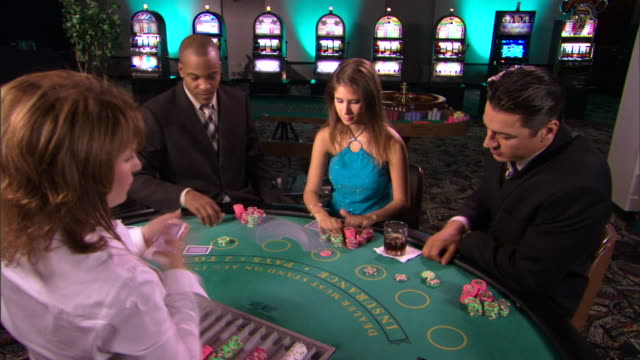 vídeos y material grabado en eventos de stock de people gambling in casino - blackjack