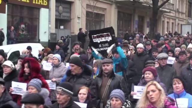 People gather and march for peace at Independence Square of Kiev Ukraine on January 18 2015 Ukrainian President Petro Poroshenko delivers a speech...