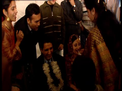 people gather around a couple during a wedding ceremony in pakistan. - pakistan stock videos & royalty-free footage