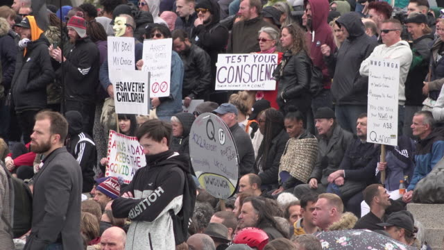 people gather around nelson's column at a coronavirus conspiracy protest on trafalgar square on september 26, 2020 in london, england. the protest... - march month stock videos & royalty-free footage