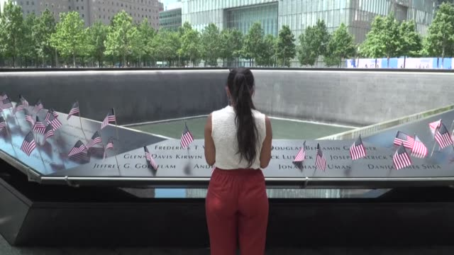 people gather around one of the pools at the 9/11 memorial as it reopens on independence day after months-long closure due to the coronavirus pandemic - july stock videos & royalty-free footage
