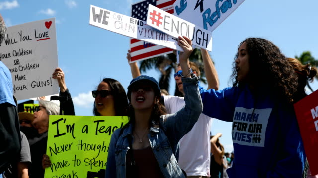 people gather as close as they can, to where president donald trump is residing at his mar-a-lago club, for a march for our lives event on march 24,... - march for our lives stock videos & royalty-free footage