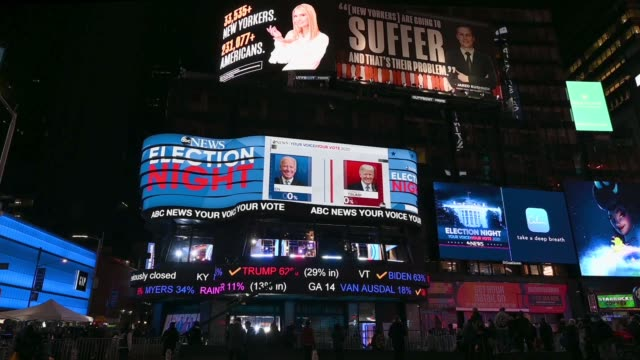people gather as early election results are reported on large digital screens in times square on november 03, 2020 in new york city. after a... - joe 03 stock videos & royalty-free footage