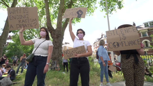 people gather at a black lives matter peaceful protest in newington green with protest signs showing their support on june 13 2020 in london england... - tranquility stock videos & royalty-free footage