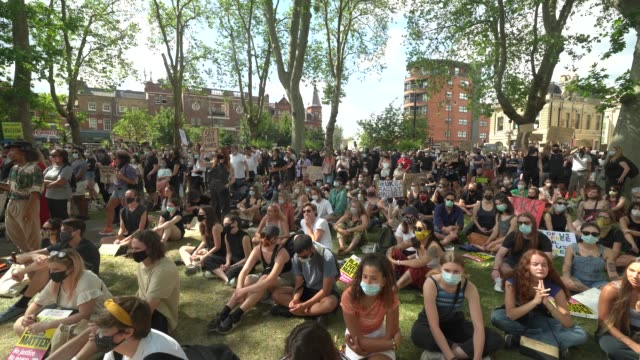 people gather at a black lives matter peaceful protest in newington green with protest signs showing their support on june 13, 2020 in london,... - tranquility stock videos & royalty-free footage