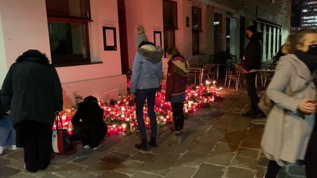 people gather at a makeshift memorial of candles and flowers at the scene of a terror attack where last monday night a gunman rampaged on november... - austria stock videos & royalty-free footage