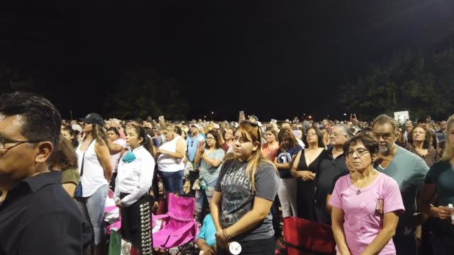 people gather at an interfaith vigil for victims of a mass shooting which left at least 20 people dead on august 4 2019 in el paso texas a 21yearold... - trauernder stock-videos und b-roll-filmmaterial