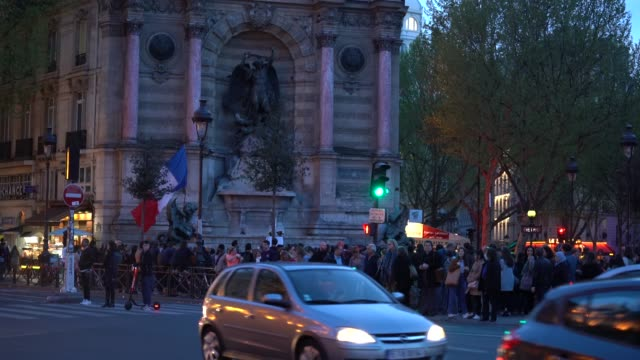people gather at fontaine saint-michel during the annual chrism mass during holy week held in the wake of monday's massive fire that damaged the... - holy week stock videos & royalty-free footage
