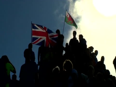people gather at mount snowdon's peak during the torch relay - flaming torch stock videos & royalty-free footage