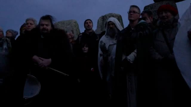 people gather at stonehenge in wiltshire to mark the winter solstice, and to witness the sunrise after the longest night of the year. - solstice stock videos & royalty-free footage