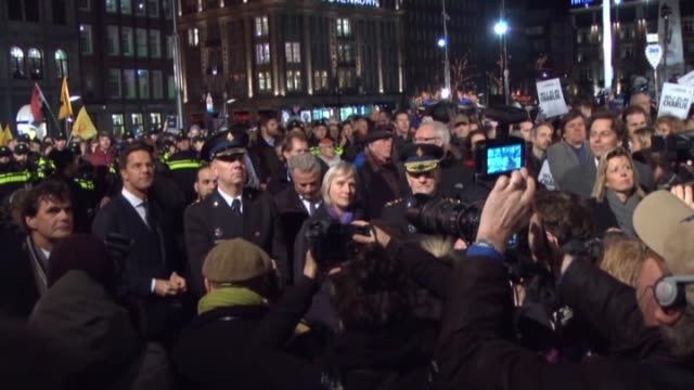 people gather at the dam square in amsterdam, netherlands on january 08 to hold a vigil following the gun attack on january 7 at the headquarter of... - satire stock-videos und b-roll-filmmaterial