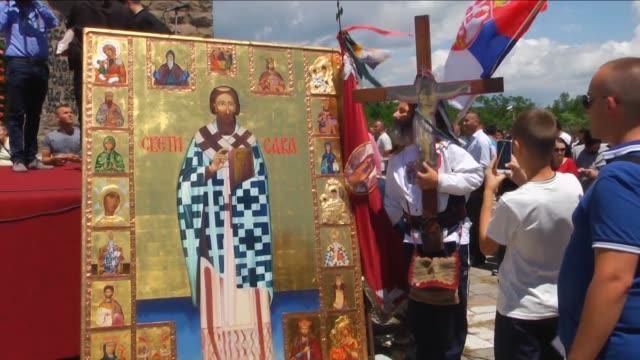 people gather at the gazimestan monument to celebrate the st. vitus day in pristina, kosovo on june 28, 2016. footage by erkin keci / anadolu agency - 聖ヴィート大聖堂点の映像素材/bロール