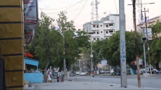 people gather at the scene of an attack after a car bomb exploded on june 1, 2016 at a top mogadishu hotel that houses several mps, killing 11... - terrorism stock videos & royalty-free footage