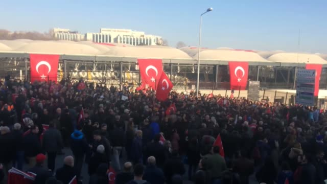 people gather at the site of the terror attack near the besiktas football club stadium vodafone arena to pay tribute to the victims of the twin... - besiktas stock videos and b-roll footage