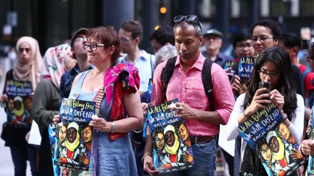people gather for a commemoration ceremony at the federal plaza in chicago, il, united states on june 22, 2017 for nabra hassanen, who was murdered... - memorial event stock videos & royalty-free footage
