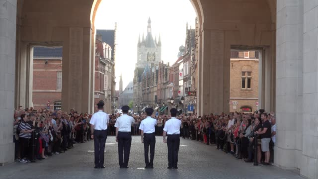 people gather for the last post ceremony at the menin gate on april 20, 2018 in ypres, belgium. themenin gate memorial is dedicated to... - anniversary stock videos & royalty-free footage