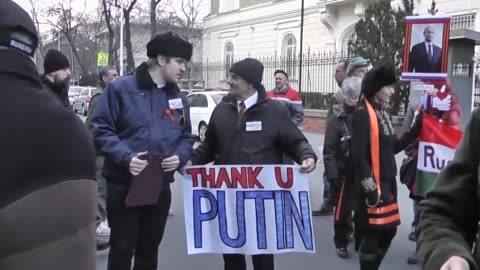 people gather in front of the russian embassy in budapest in order to stage a support rally for russian president vladimir putin as he pays a one-day... - ungersk kultur bildbanksvideor och videomaterial från bakom kulisserna