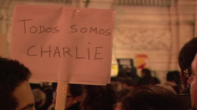 people gather in lisbon for a candle-lit vigil following the deadly attack on french satirical magazine charlie hebdo, which killed 12 people - satira video stock e b–roll