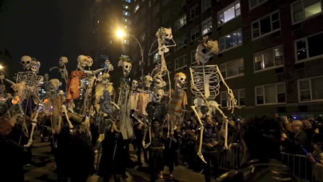 people gather in new york streets for halloween celebrations in united states on 31 october 2014 - woodwind instrument stock videos and b-roll footage