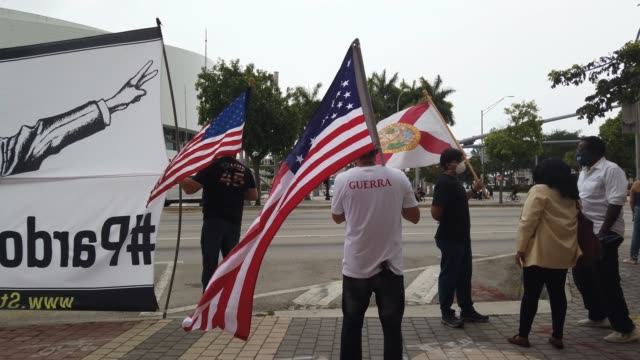 people gather in protest in front of the freedom tower during the coronavirus pandemic on april 25 2020 in miami florida protesters were demanding... - florida us state stock videos & royalty-free footage
