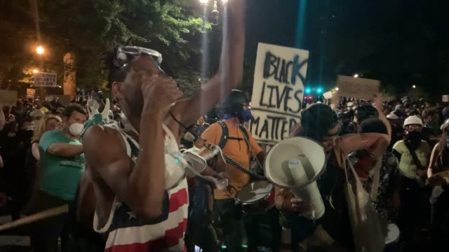 people gather in protest in front of the mark o. hatfield federal courthouse in downtown portland as the city experiences another night of unrest on... - portland oregon stock videos & royalty-free footage