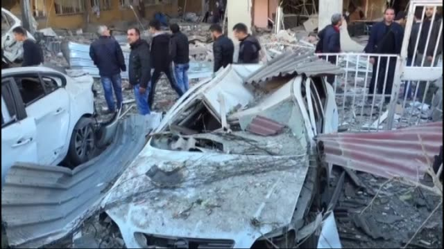 people gather near the explosion site on november 04, 2016 after a strong blast in the southeastern turkish city of diyarbakir. two police, six... - police statement stock videos & royalty-free footage