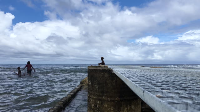 people gather on a pier on december 06 2019 in tanna vanuatu 25 percent of vanuatu's 276000 citizens lost their homes in 2015 when cyclone pam a... - south pacific ocean stock videos & royalty-free footage
