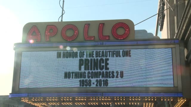 people gather outside the apollo theater to listen to music by prince as news of the music legends sudden death aged 57 prompts a flood of tributes - prince stock videos & royalty-free footage