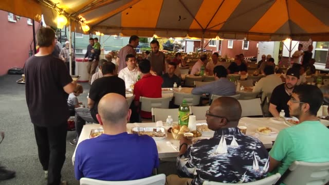 people gather to break their fast at a fastbreaking dinner at grand mosque in new york united states on june 6 2016 - moschea video stock e b–roll