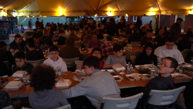 people gather to break their fast at a fastbreaking dinner at ulu mosque in new jersey united states on may 6 2019 - ramadan stock videos and b-roll footage