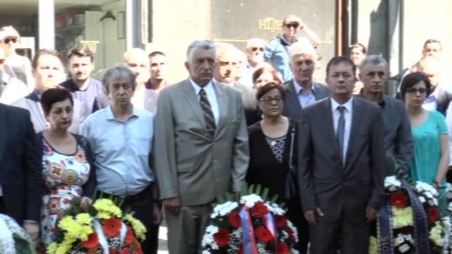 people gather to mark 20th anniversary of deadly market massacre which 43 victims were killed when a mortar fired from bosnian serb positions above... - 20th anniversary stock videos & royalty-free footage