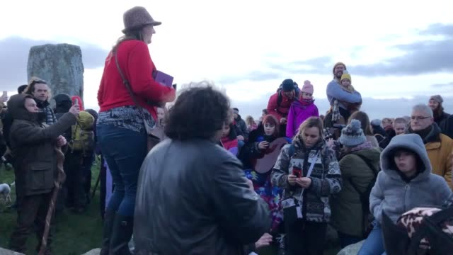 people gather to mark the winter solstice at stonehenge in wiltshire, and to witness the sunrise after the longest night of the year. - solstice stock videos & royalty-free footage