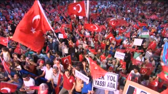 people gather to protest against july 15 failed military coup attempt at taksim square in istanbul turkey on august 01 2016 turkish officials accuse... - staatsstreich stock-videos und b-roll-filmmaterial