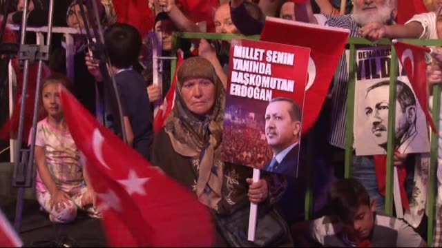 people gather to protest against parallel state/gulenist terrorist organization's failed military coup attempt at fomara square in bursa turkey on... - staatsstreich stock-videos und b-roll-filmmaterial