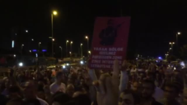 people gather to react against uprising attempt from within the army at ataturk international airport in istanbul turkey on july 16 2016 - army video stock e b–roll
