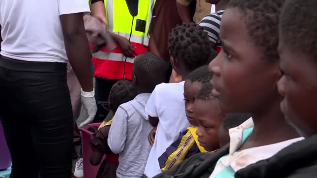 people gather to receive aid after around 2000 people were rescued by boat from buzi an area heavily devastated by the cyclone idai which hit... - mozambique stock videos & royalty-free footage