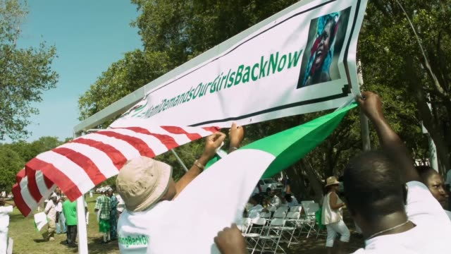 ms people gather to support the coalition of concerned nigerians in south florida during a rally to show support for national and international... - florida south africa stock videos & royalty-free footage