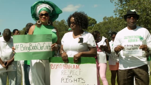 ws people gather to support the coalition of concerned nigerians in south florida during a rally to show support for national and international... - florida south africa stock videos & royalty-free footage