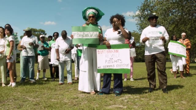 ls people gather to support the coalition of concerned nigerians in south florida during a rally to show support for national and international... - florida south africa stock videos & royalty-free footage